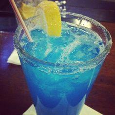 Tiffany's lemonade. My new favorite drink. Lemonade, peach schnapps, and blue curaçao. In love