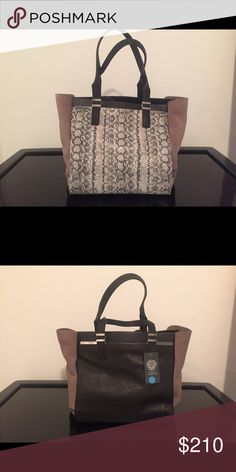 Vince Camuto Snake Skin Bag This is such a beautiful bag! Originally priced at $328 but bought on sale for $225 total! So anything lower than what I paid for it is an even BIGGER steal then what I got it at! Vince Camuto Bags Shoulder Bags
