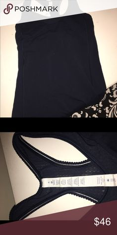 Cute Lululemon tank size 6! Super cute Lululemon tank in navy blue. This top has a built in bra and is in excellent condition. I only wore it a few times because I realized I needed a different size. No rios, stains or tears. Let me know if you have any questions! Bundle with another item in my closet and save 20%! lululemon athletica Tops