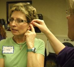 Working on lower back reflex. Ear Reflexology. www.AmericanAcademyofReflexology.com