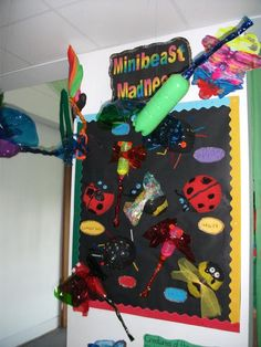 minibeasts  bulletin board made from recycled materials