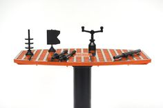 Alignment tools are hardened machined steel, hard anodized 6061 Aluminum  and ductile iron.   Table top and base not included.