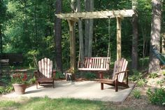 """Backyard Patio and arbor with swing.  """"LEAVE YOUR CARES BEHIND...JOIN US ON THE PATIO"""