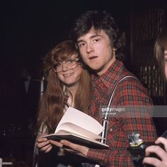 Les McKeown of pop group the Bay City Rollers poses signing autograph for a fan in May 1976 in Copenhagen, Denmark.