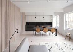Enter a creamy, wood-wrapped apartment in London designed by Proctor & Shaw – the perfect embodiment of its chic neighbourhood. London Apartment, Apartment Interior, Casa Cook, Two Bedroom Apartments, Bedroom With Ensuite, Kitchen Fixtures, Floor Finishes, Open Plan Kitchen, Open Plan Living