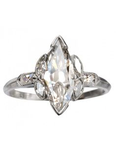 Marquise-Cut Diamond Engagement Rings   Martha Stewart Weddings - Erie Basin 1920s Art Deco Marquise Ring, $8,995, ErieBasin.com.