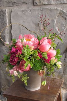 Centerpiece with curly willow branches, jasmine vine, David Austin 'Darcey' garden roses, Hot Majolika spray roses, Coral Charm peonies...