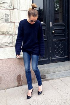 15 Crazy Cool Top Knots: Caroline Sandstrom // bun, navy sweater, skinny jeans & pumps #style #fashion