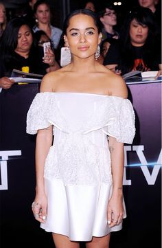 Zoe Kravitz wears an off-the-shoulder Balenciaga dress with bold chandelier earrings.