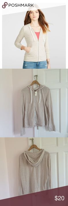 NWT Lightweight Zip Up Hoodie Aeropostale beige lightweight slub jersey zip up hoodie. Tag says XXL but would fit smaller as well. I wear a S/M and could wear it as a looser fit hoodie. I'm assuming it would be form fitting on an XXL as shown in stock photo but since I don't wear that size I cannot verify if it may run small or not. Please be aware of this before purchasing. Feel free to ask questions. Only tried on to verify sizing. Also available in black and grey. Aeropostale Tops…