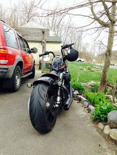Harley Forty Eight with chain drive and fat rear tire.