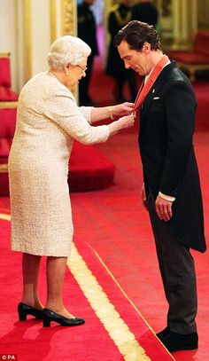 Benedict Cumberbatch receiving the CBE. Memorable: The Queen herself was there to deliver the honour at the Investiture Ceremony