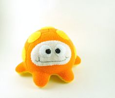 Large Fluffcrobe Plush Alien Microbe Stuffed Animal in Neon Orange and Yellow. $20.00, via Etsy.