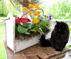 Flower box made with picket fence pieces and a really crooked stick