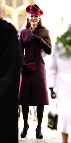 DECEMBER 25, 2011 For her first holiday as a royal, Kate Middleton wore a dark purple coat designed by an independent British dress maker to attend services at St. Mary Magdalene Church. She accessorized her look with a trilby by Jane Corbett, matching clutch, black gloves, black pumps, and a new pair of drop green amethysts earrings by Kiki McDonough.