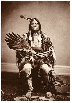 Flying Pipe, (aka Canupa Kinyan), Yankton Sioux. ... He holds an iron pipe-tomahawk and an eagle wing fan. Photo by William Henry Jackson, c. 1872.