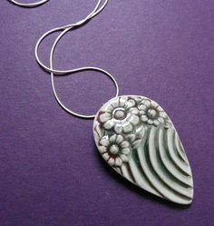 ceramic pendant on silver chain