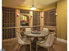 A wine cellar complete with a table and chairs to sit down  with friends and enjoy a fine vintage right there on the spot. A wonderful idea #Innovative #Wine #Cellar