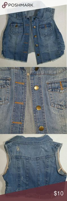 Jean distressed look vest ??????Get in on the seasons trendy looks.?????? Used great condition vest. Fit is cropped. Size is large . Two pockets on the front. Handwash only. Tops Crop Tops