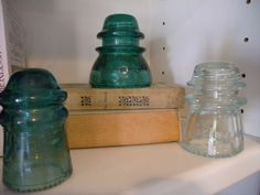 Clockworkinteriors.com - Beautiful blue glass insulators were purchased at a garage sale for only 50 cents a piece!