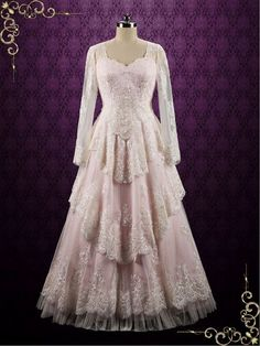 Vintage style lace wedding dress with tiered skirt and long lace sleeves, finished with a keyhole lace up back. Photoed in pearl pink, can also be made in another color such as all ivory or white. Wor