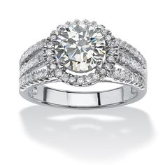 This fashionable and elegant ring is set with 2.53 carat of sparkling cubic zirconia gemstones in a dazzling, bold design. The stones are set into lustrous platinum over silver that is enhanced with a high polish finish, giving the ring a radiant shine.