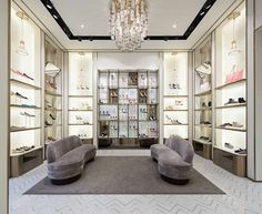 the jimmy choo retailer is a combination of contemporary design paired with classical elegance located in chengdu, china by christian lahoude studio. Boutique Interior, Showroom Interior Design, Retail Interior, Boutique Design, Shoe Store Design, Jewelry Store Design, Retail Store Design, Retail Stores, Jewelry Shop