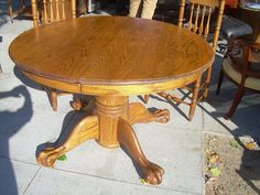 PHOTOBUCKET | ANTIQUE ROUND TABLE WITH METAL CLAW FEET PICTURES