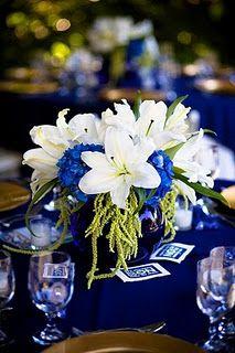 Midnight Blue Flower Centerpiece. This would be pretty w/ orange (tiger?) Lilys instead of white :). @Diedra Gaston