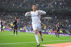 Cristiano Ronaldo celebrates after scoring his team's opening goal during the La Liga match between Real Madrid CF and Rayo Vallecano de Madrid at Estadio Santiago Bernabéu on March 2014 in Madrid, Spain. Ronaldo Real Madrid, Cristiano Ronaldo, Scores, Goals, Celebrities, Legends, Spain, March, Photos