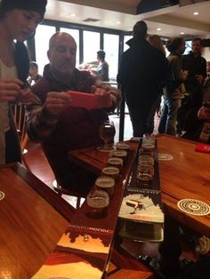 Beer tasting - love the presentation with the ski and logo | Yelp