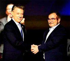 Santos et 'Timochenko' signe le nove acordo de pace