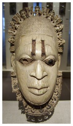 16th century Edo pendant mask, carved in ivory, from the Court of Benin, Nigeria. http://www.artyfactory.com/africanmasks/masks/kwele.htm