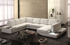 This spectacular modern sectional sofa comes with LED lights, storage space, and upholstered in White Top Grain Leather. Not in stock. Special order item. Available in variety of colors and leather ty