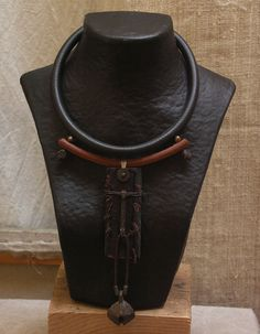 Ethnic necklace with ebony and an old bronze bell