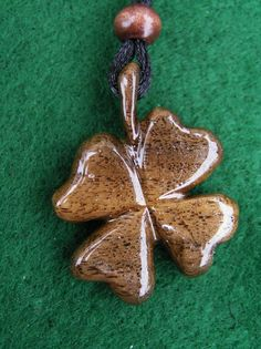 "Carved Four Leaf Clover Walnut Wood, 1 1/4"" x 1 3/8"" Pendent Necklace."