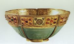 Turquoise glass bowl -  the glass, made in Iran or Iraq, dates from the 9th or 10th centuries; the Byzantine enamel from the 11th century, the metalwork from between the 10th and 15th centuries.