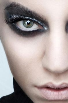 Black and white makeup with silver sparkle