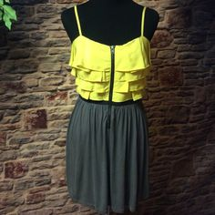 ELLE COLOR BLOCK DRESS Pretty dress in yellow and gray with an elastic banded black waist and exposed zipper. Adjustable Spaghetti straps. Gently used.  HIC-2 Elle Dresses
