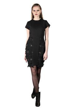 Yan To reverse neoprene dress with cutaway skirt.