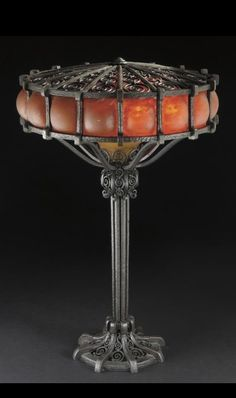 Edgar Brandt and Daum TABLE LAMP both shades engraved DAUM NANCY with the croix de Lorraine base stamped E.BRANDT wrought iron and glass 20 1/2 in. (52 cm) high 13 1/4 in. (33.7 cm) diameter of shade ca. 1925