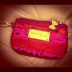 Betsey Johnson Sequin Coin Purse NEW, Never used, fuchsia colored w/sequins. It is a top zip keychain coin purse with a logo hang tag (as the zipper) and key hook to hang inside of purse. It has a clear Window on the back for your ID (or pictures/cards) to be seen through. Shake things up with this petite sequined pouch from Betsey Johnson! Betsey Johnson Bags Clutches & Wristlets