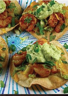 Avocado Crema over Shrimp Tostadas with Greek Yogurt — Loaded with so many delicious flavors from all the spices and the creamy sauce, this recipe makes for one perfect party appetizer or quick lunch!