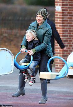 Gwen Stefani wearing original tall Hunter Boots green. http://townshoes.com/brands/hunter/