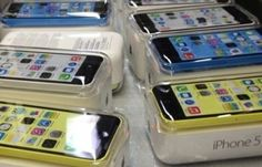 The iPhone 5C in yellow, blue and white colours - compare the cheapest contract offers at PhonesLimited.co.uk