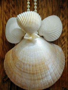 Anjo de conchas