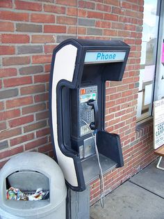 White Phone-Shaped Pay Phone by The Upstairs Room, via Flickr