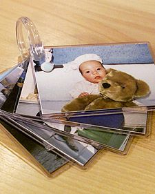 Babies love to look at pictures, especially when they're looking at things they're familiar with, like family photos. But since it's not wise to let babies hold your precious photos, here's another idea: Give your baby a simple and inexpensive photo that you can hook to the stroller.