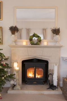 Get the appearance of a fireplace with your wood stove by framing it in a mantel & surround. Marsh's Stoves & Fireplace in Toronto ON Stove Fireplace, Fireplace Design, Fireplace Mantles, My Living Room, Home And Living, Corner Wood Stove, Wood Burner, Living Room Inspiration, Decoration