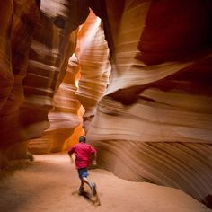 Photo by @mike_hettwer -ANTELOPE CANYON  A Navajo boy runs through the dramatic Upper Antelope Canyon on the Navajo Reservation. Its a slot canyon near Page Arizona in the US. The site was formed by the erosion of the sandstone and is just outside the Glen Canyon National Recreation Area.  #navajo #slotcanyon #navajoreservation #arizona #glencanyon #flashflood #antelopecanyon @natgeo @mike_hettwer by natgeo